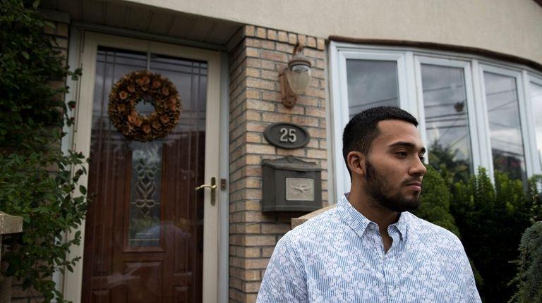 Brandon Valle, 20, of Westbury talks with media