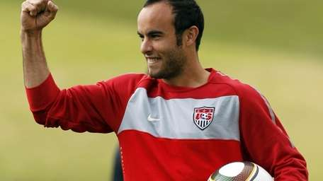 Landon Donovan holds up his fist during training