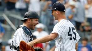 Chasen Shreve, right, bailed out Aroldis Chapman by