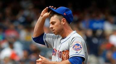 Steven Matz of the Mets looks on from