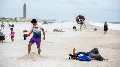 A beachgoer digs a hole at field 2,