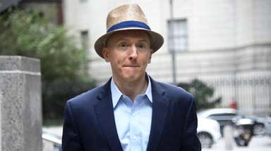 Former Trump campaign aide Carter Page exits a