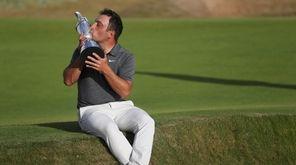 Francesco Molinari of Italy kisses the trophy after