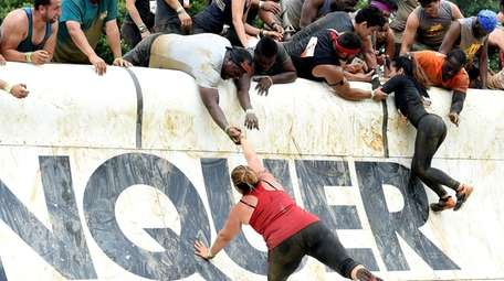 """Participants engage in the """"Everest"""" obstacle during the"""