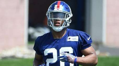 Giants running back Saquon Barkley participates during OTAs