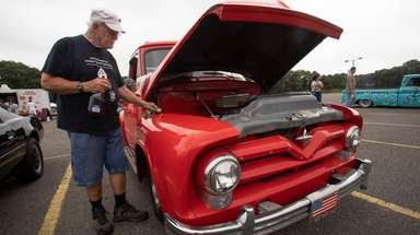 Jim Joyce, of Patchogue, cleans his 1955 Ford