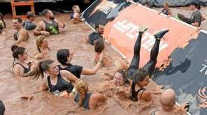 About 8,000 mud-soaked people participated in the Tough