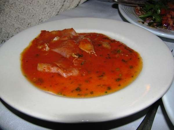 Plate of prosciutto in tomato sauce at Cafe