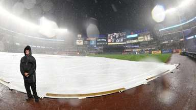 The tarp is on the field during a