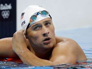 United States' Ryan Lochte checks his time in