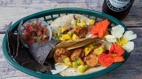 Surf tacos are filled with Charissa-dusted shrimp, mango-pineapple