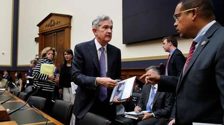 Federal Reserve Board Chair Jerome Powell, left, speaks
