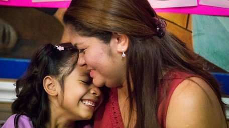 Cindy Madrid with her daughter, Alison, 6, on