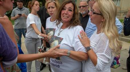 Patty Kontonis, second from right, reacts at the