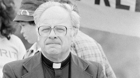 Roman Catholic Archbishop Raymond Hunthausen of Seattle sits