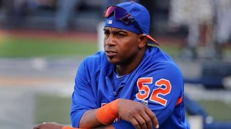 The Mets' Yoenis Cespedes stretches before a game