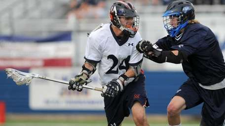 Manhasset High School #24 Matt Tompkins, left, gets