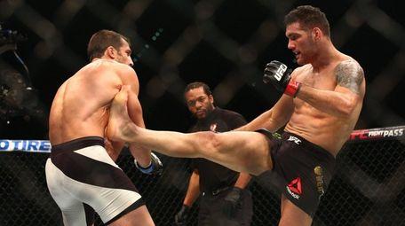 Luke Rockhold defeated Chris Weidman by TKO in