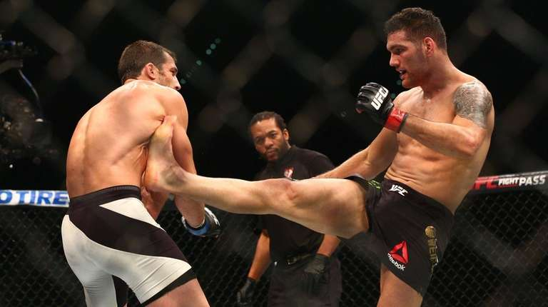Luke Rockhold defeated Chris Weidman by TKO in