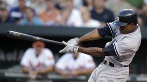 New York Yankees' Curtis Granderson swings on an