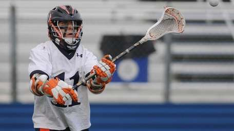 Manhasset High School #11 Chris Cook makes a