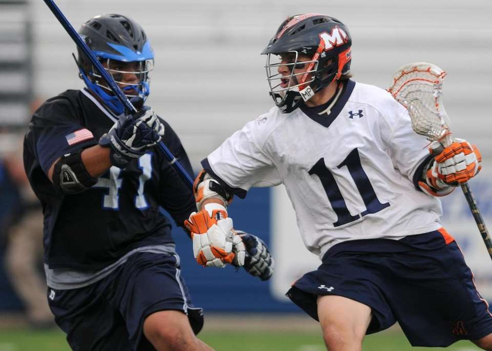 Manhasset High School #11 Chris Cook, right, gets