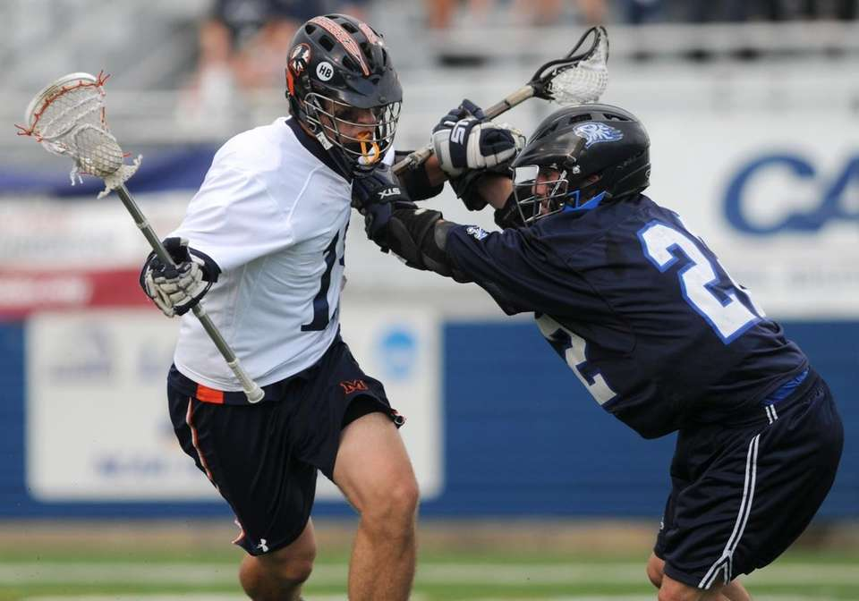 Manhasset High School #13 Harry Kucharczyk, left, gets