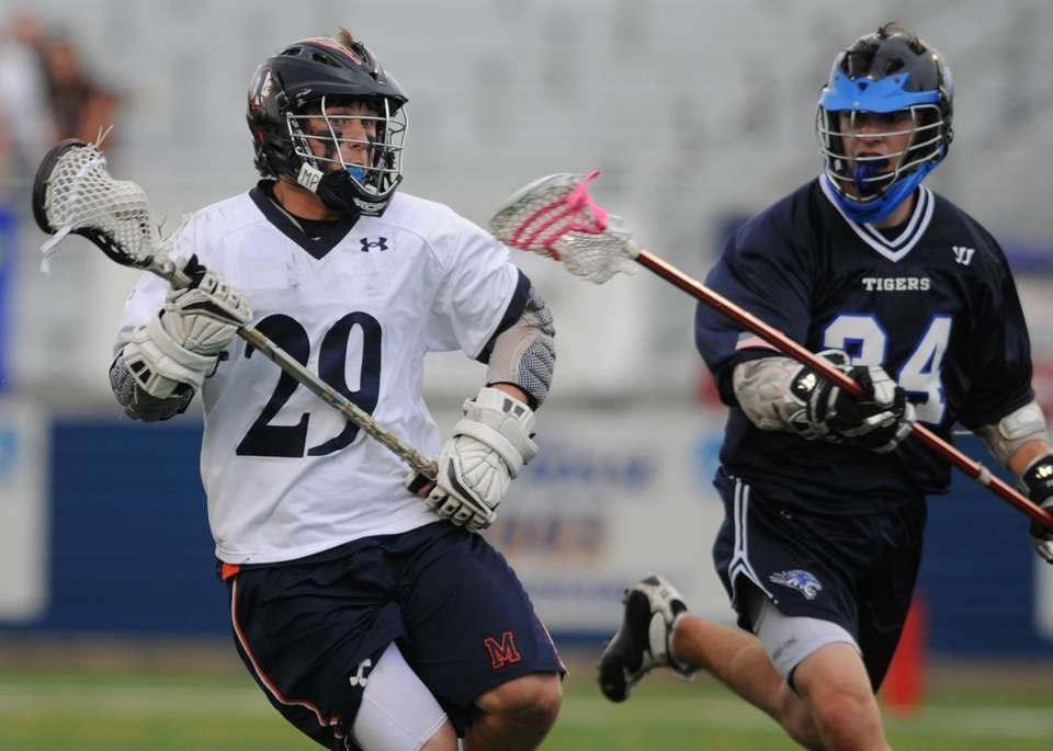 Manhasset High School #29 Ricky Buhr, left, gets