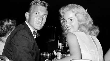 Actor Tab Hunter, with actress Tuesday Weld, at