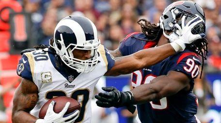 Rams running back Todd Gurley pushes away Texans