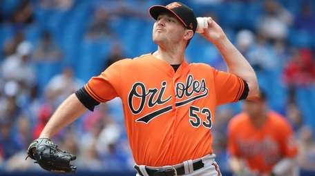 Zach Britton of the Orioles pitches in the