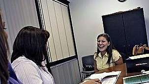 Jessica Vargas laughs during a job interview with