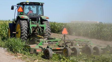 Farmer Tim Novotny of Wahoo, Neb., works in