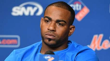 Mets' Yoenis Cespedes looks on during a news