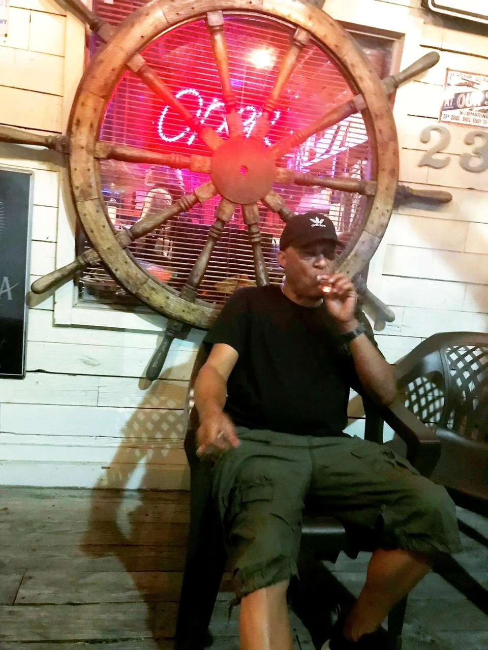 Owner Miles Fox enjoys a late night cigar