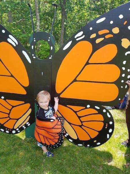 Pierce dressing up as a butterfly at Migratory