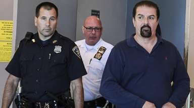 Steven Pagartanis leaves his arraignment at Suffolk County
