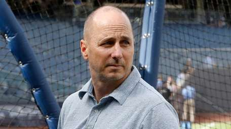 Yankees general manager Brian Cashman looks on during