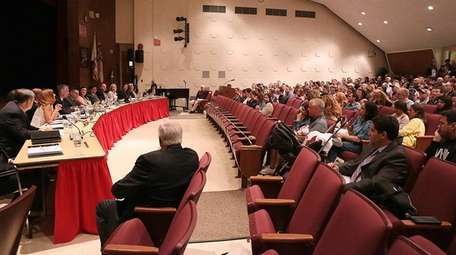 Syosset residents fill the auditorium at South Woods