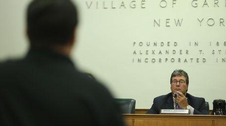 Brian Doughy, Mayor of Garden City, listens to