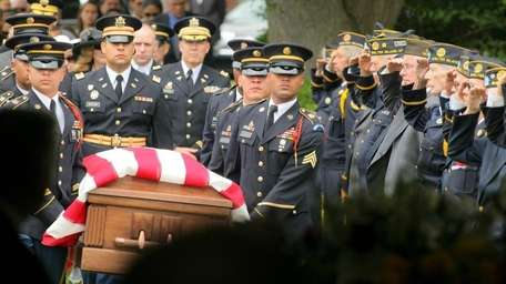 The coffin is carried in at the funeral