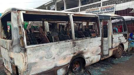 A July 10 photo shows burned buses at