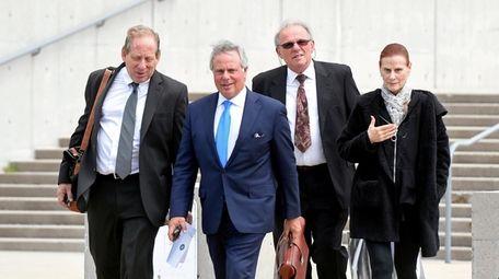 Bruce Bendell, far left, leaves federal court in