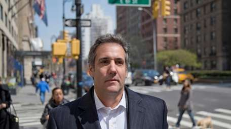 Michael Cohen walks down the sidewalk in Manhattan