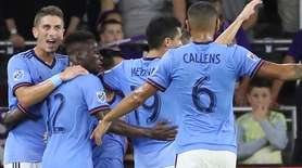 New York City FC players celebrate after a