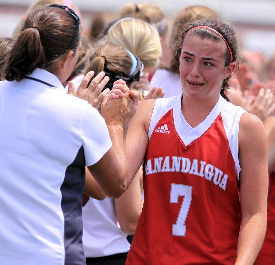 Garden City's coach Diane Chapman congratulates Canandaigua's Taylor