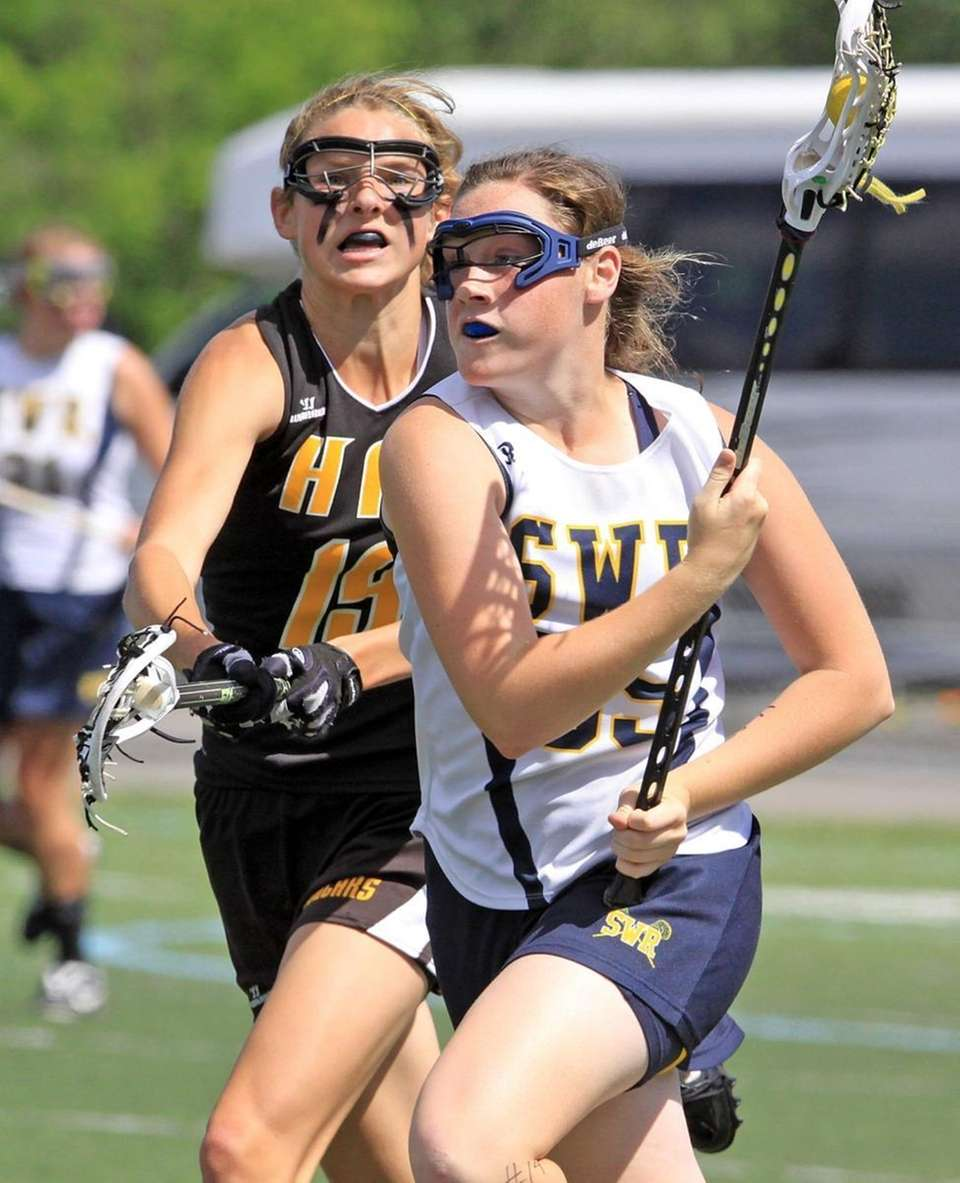 Shoreham-Wading River's Jess Angerman takes ball up field