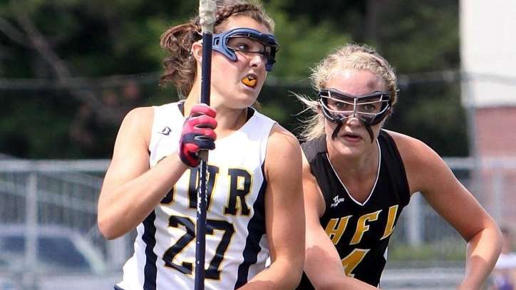 Shoreham-Wading River's Codi Mullen works against HFL's Amanda