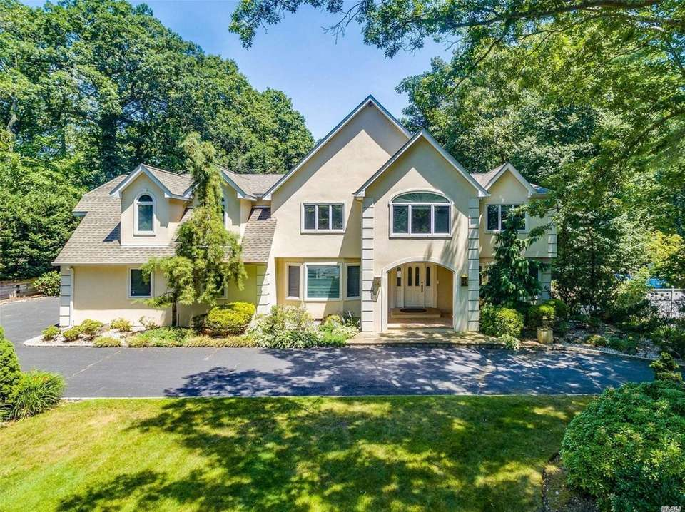 This Dix Hills Postmodern includes five bedrooms and