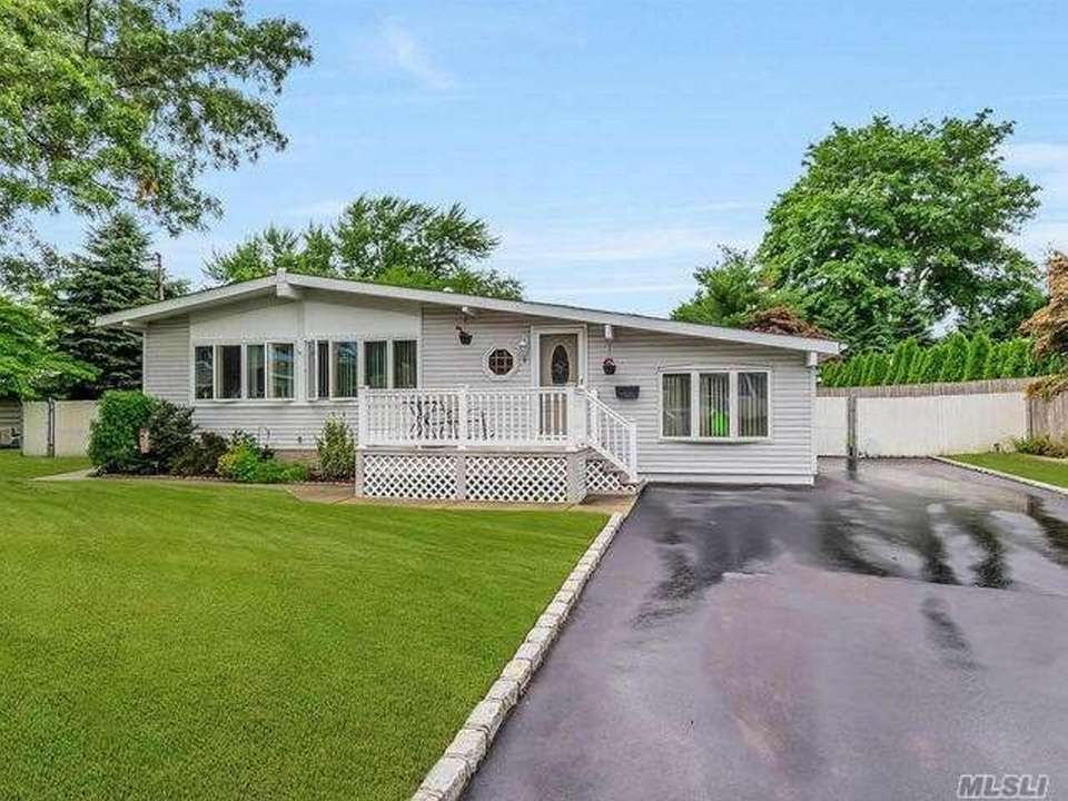 This Lake Ronkonkoma ranch includes three bedrooms and
